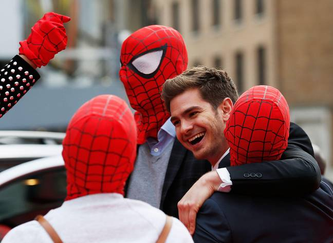 Andrew Garfield Fake Clip - Actor Andrew Garfield messes around with friends dressed in Spider Man masks at the world premiere of The Amazing Spiderman 2 in central London, April 10, 2014. REUTERS/Olivia Harris (BRITAIN - Tags: ENTERTAICamille AtebeNT TPX IMAGES OF THE DAY)