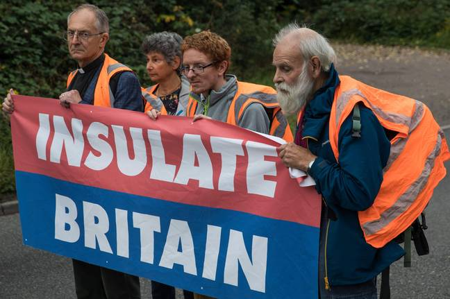 Godstone, UK. 13th September, 2021. Insulate Britain climate activists block a slip road from the M25, causing a long tailback on the motorway, as part of a new campaign intended to push the UK government to make significant legislative change to start lowering emissions. The activists, who wrote to Prime Minister Boris Johnson on 13th August, are demanding that the government immediately promises both to fully fund and ensure the insulation of all social housing in Britain by 2025 and to produce within four months a legally binding national plan to fully fund and ensure the full low-energy an - (Mark Kerrison/Alamy)