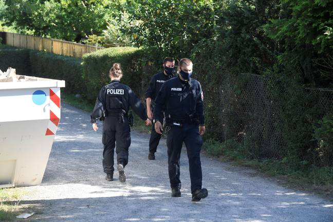Madeleine McCann - Police walk along the site after they started digging in an allotment area near Hanover, Germany July 29, 2020, where Christian B, a suspect in the Madeleine McCann investigation lived for a while some years ago. REUTERS/Fabian Bimmer